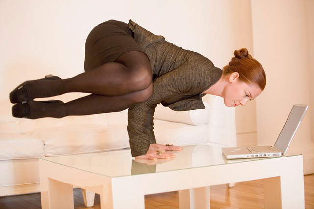 Woman yoga in the office