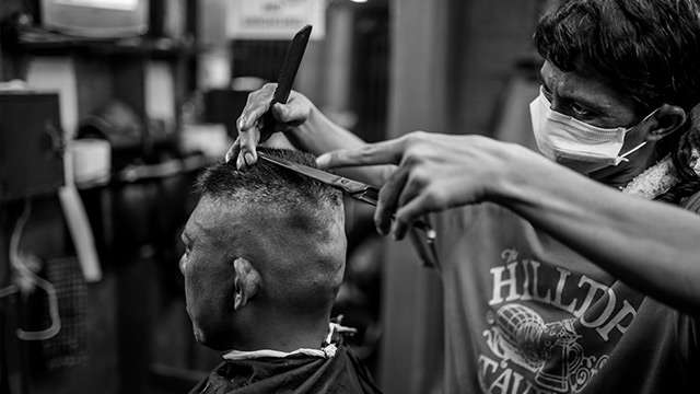 PHOTO ESSAY: A Day In The Life Of A Remarkable Small-Time Barbershop