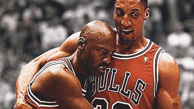 Michael Jordan And Scottie Pippen Share Candid Moment During Game