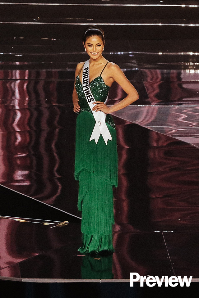 "f10aa76bb4dc5 ""It's not your typical pageant gown,"" Rhett says of Maxine's emerald green  column dress."