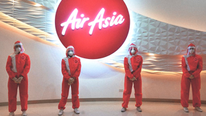 Airasia Just Introduced Red Hot Ppe Suits By Filipino Designer For Its Cabin Crew