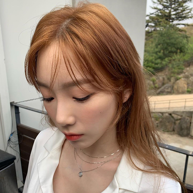 girls generation's taeyeon with copper-colored hair