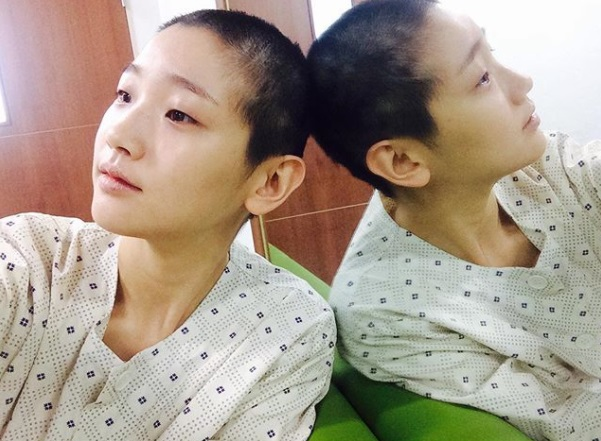 park so dam shaves her head for her role in the movie the priest