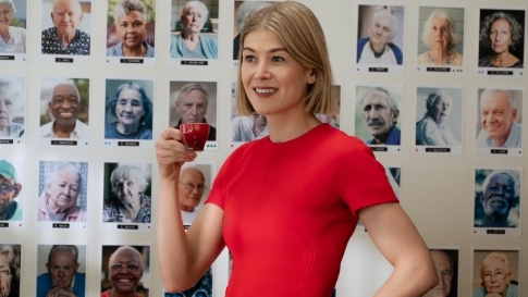 All Of Rosamund Pike's Stylish Villain Outfits In