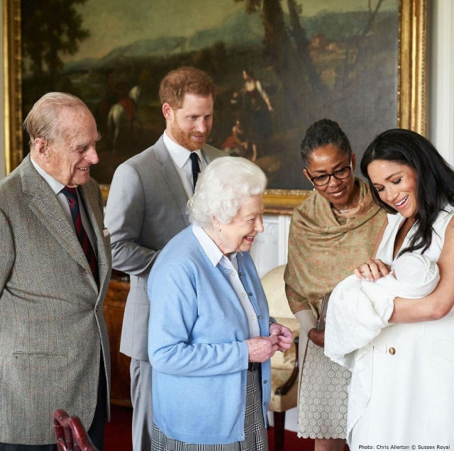 prince harry with meghan markle and queen elizabeth ii