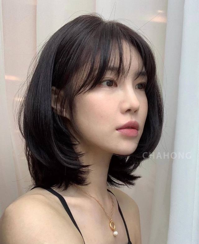 permed korean haircut with curtain bangs