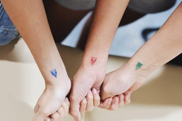 colored triangle tattoos