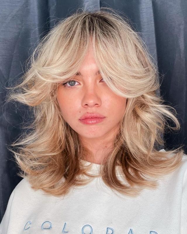 mid-length hair with curtain bangs