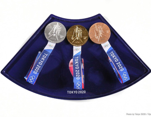 why athletes bite medals