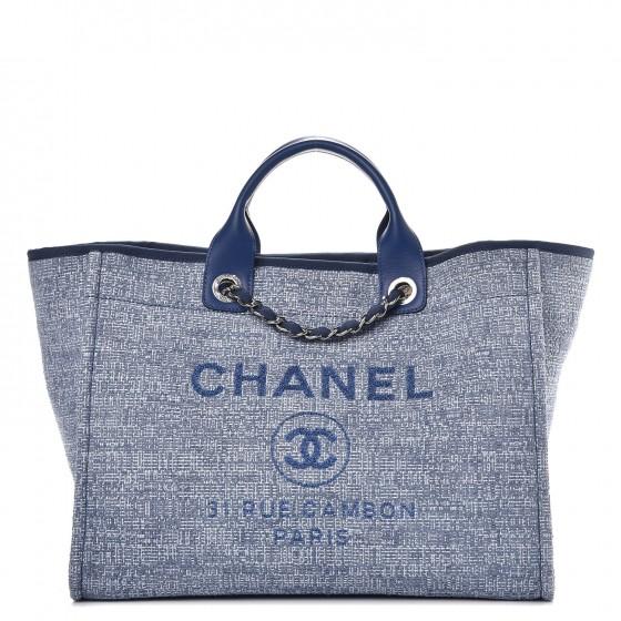 verniece enciso's designer bags at the beach