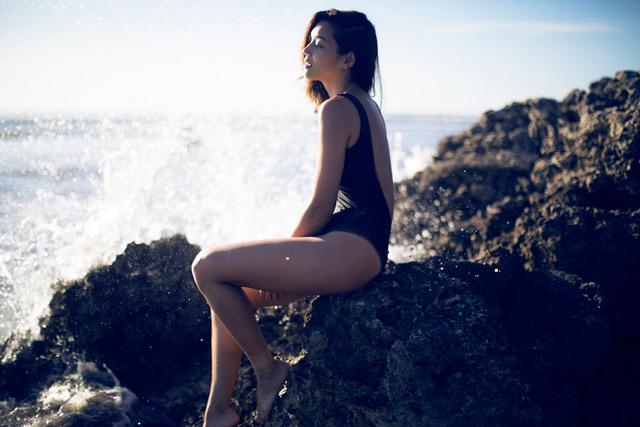 Kim Jones in a blue bathing suit