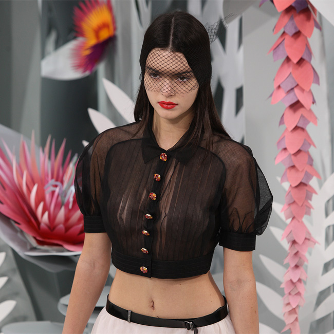 Kendall goes braless for Chanel show