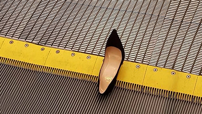 A Louboutin Heel Broke The Condé Nast Escalator