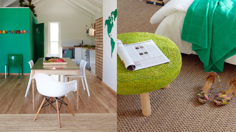 A tiny house with a refreshing green and white palette rl