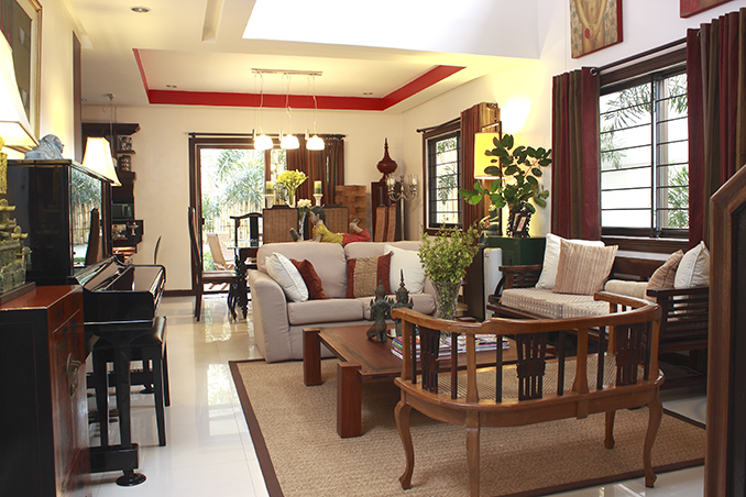 A collection of art pieces and flea market finds in a for Living room interior design philippines