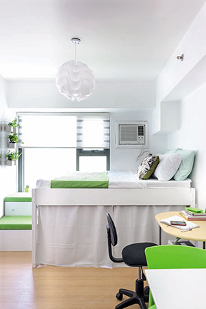 The interior designer replaced the unattractive bunk bed with an elevated  bed. The concealed space underneath can now be used to store different  belongings.