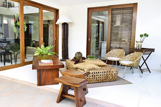 Nikki Gil's Modern Tropical Three-Storey House in Las Pinas on residential house interior design, tropical modern bathroom, tropical modern decor, tropical modern pillows, tropical modern office, tropical modern architecture, tropical modern kitchen cabinets, tropical modern living room,