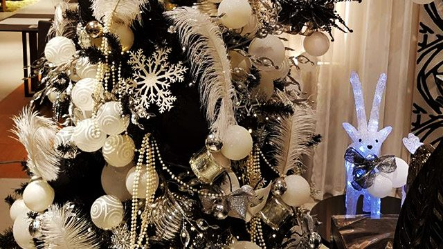 An Urban Style Christmas Tree In Ebony Is Adorned With Glamorous Black Velvet Top Hats And Plush White Silver Feathers Masks