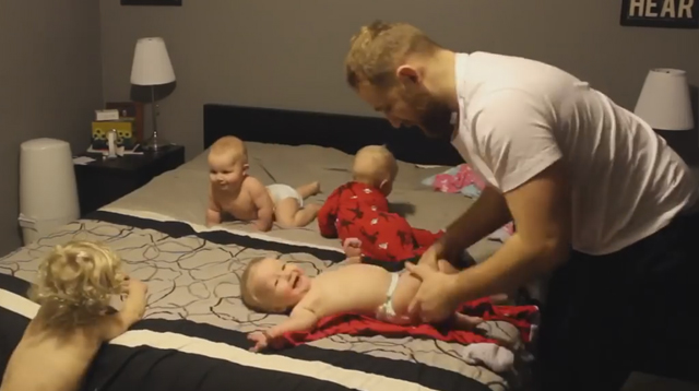This Made our Day: Dad Helps Out the Mom Who Dressed Her 4 Babies at the Same Time