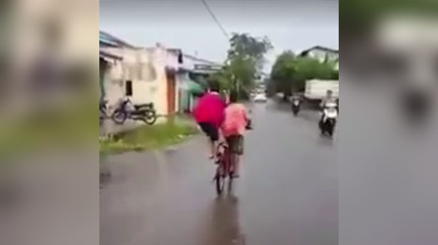 Watch: Two Boys Share One Bike in the Most Awesome Way