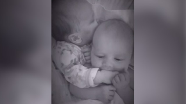 Aww! Watch How This Newborn Soothes Her Crying Twin Brother