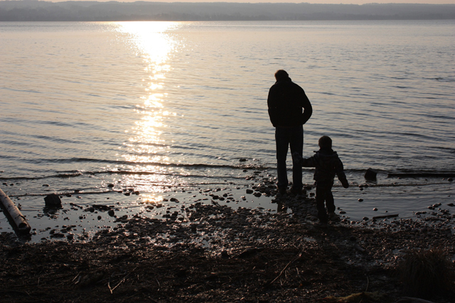 dad and kid by the beach