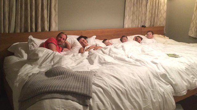 This Family of Six Sleeps Together on an 18-foot Bed