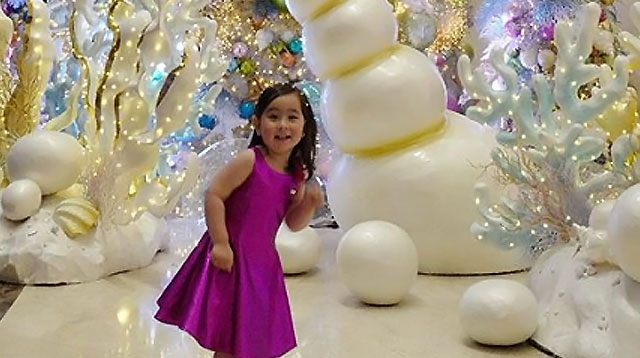 Scarlet Snow Marvels at Christmas Underwater 'Surprise'