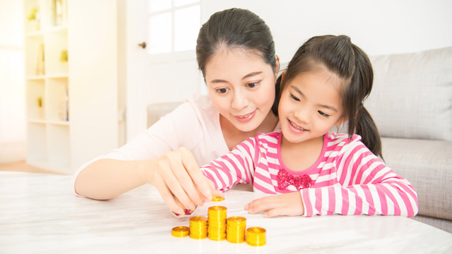 How to Begin Teaching Kids About Money, Whether She's 4 or 12 Years Old
