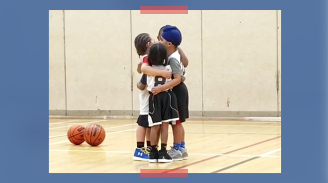 Kids Show One Another Some Love With A Group Hug At A Basketball Game!
