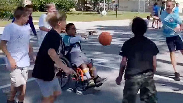 Grade 5 Students Play Inclusive Basketball Game With Student In Wheelchair