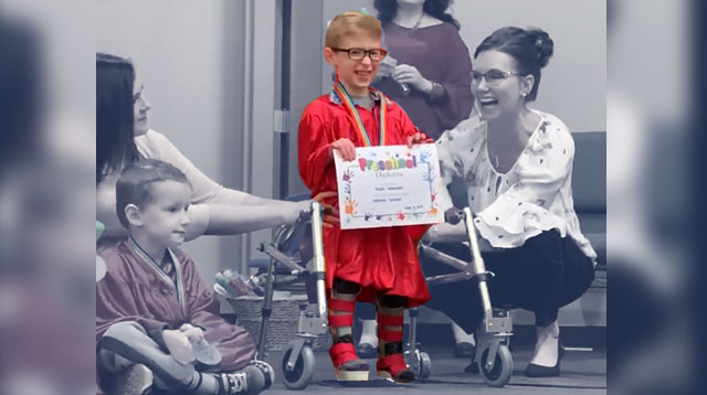 Boy With Spina Bifida Walks to Collect Diploma at Preschool Graduation