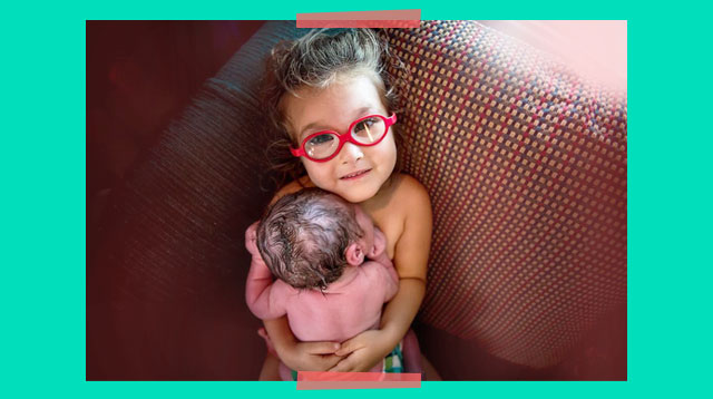 LOOK: Big Sister's Skin-to-Skin Moment With Her Newborn Brother