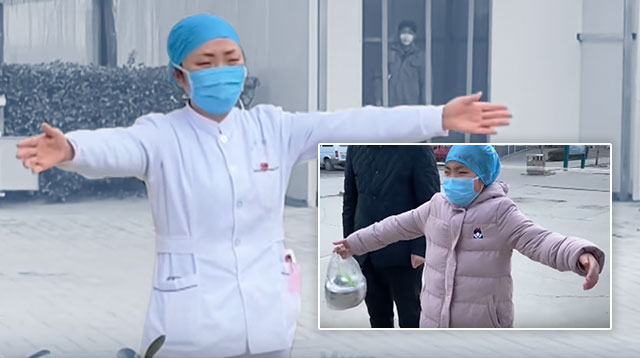 WATCH: Chinese Nurse Resorts To 'Air Hugs' To Comfort Her Daughter Amid nCoV Scare