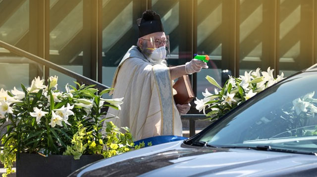 Priest Uses Squirt Gun Filled With Holy Water For Drive-by Church 'Blessings'