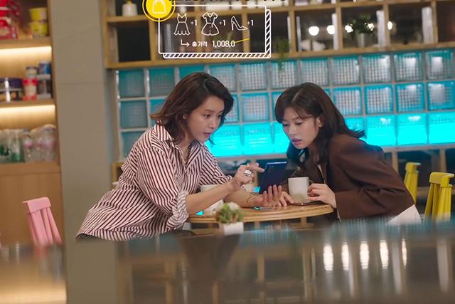 Two women browsing through a phone