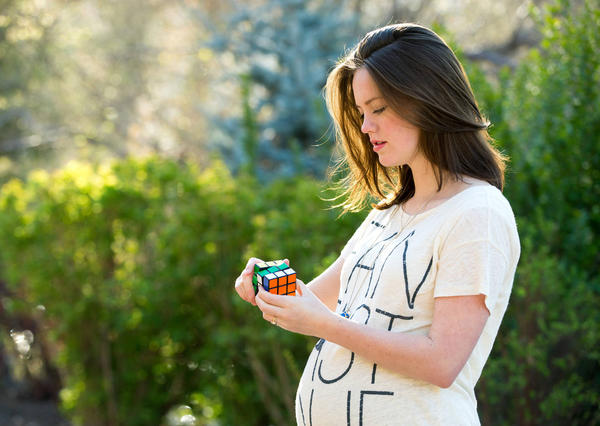 Pregnant woman with a Rubik's Cube