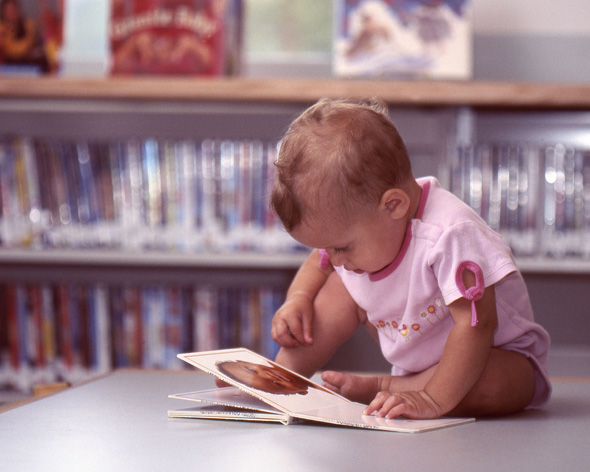 Baby looking at a picture book