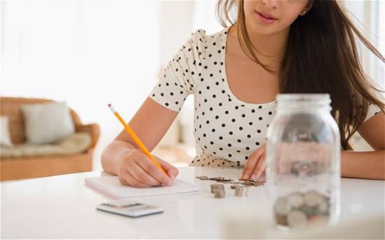 woman saving coins