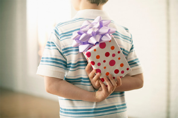 boy holding a gift