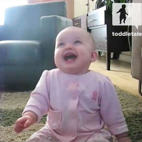 This Made our Day: Baby Laughs Hysterically At Popcorn-eating Dog