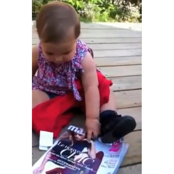 This Made our Day: Watch What Happens when a Baby Sees a Magazine for the First Time