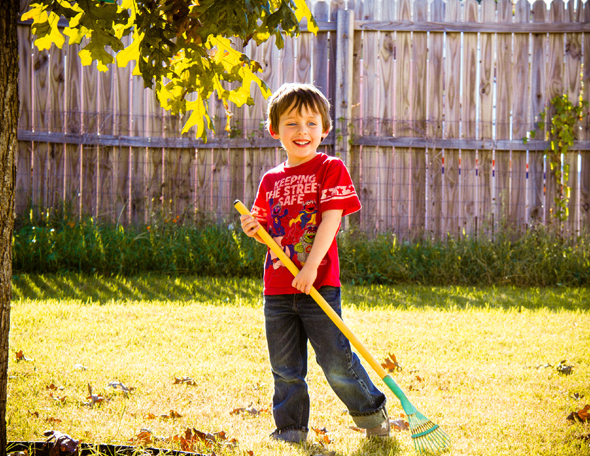 A child raking leaves