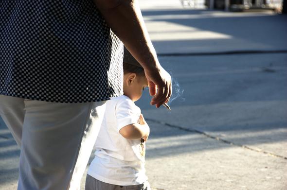 Parent smoking while walking with child