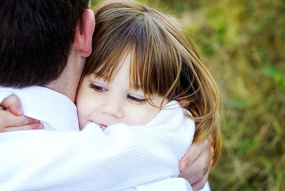 child hugging dad tightly