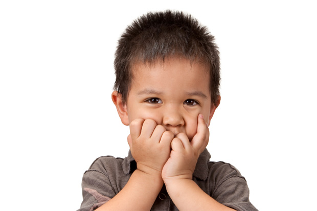 child covering his mouth