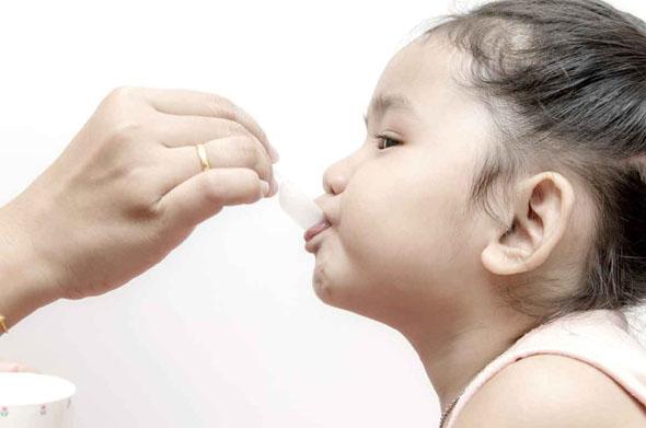 Child taking her medicine