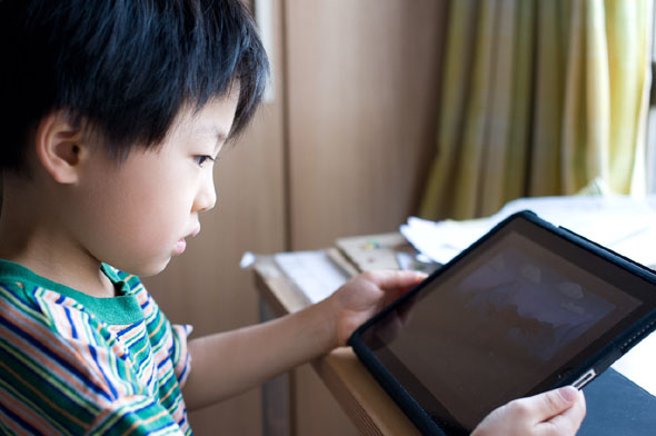 Kid with a tablet