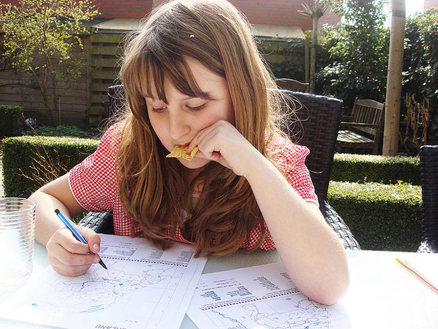 girl studying homework outdoor