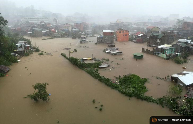 Houses partially submerged in floods waters caused by heavy rains brought by Typhoon Koppu
